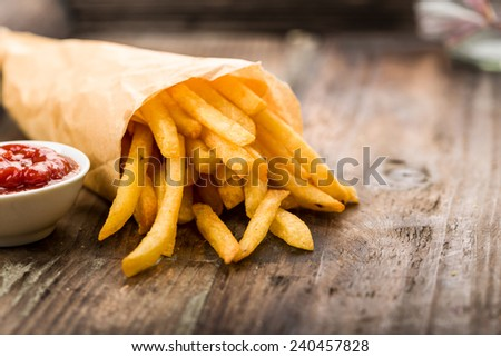 Fresh fried french fries with ketchup on wooden background ストックフォト ©