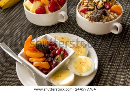 Fresh fruit and oatmeal with nuts and fruit toppings for breakfast