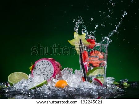 Fresh fruit cocktail in freeze motion splashing, close-up. stock photo