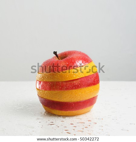 Fresh fruit consisting of segments a red apple and orange