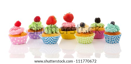Fresh fruit cupcakes isolated over white background