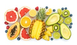 Fresh fruit healthy diet concept. Tropical mixed citrus food background, pineapple, orange isolated on white. Colorful fruits berries. Dieting health meal vegetarian health concept, top view