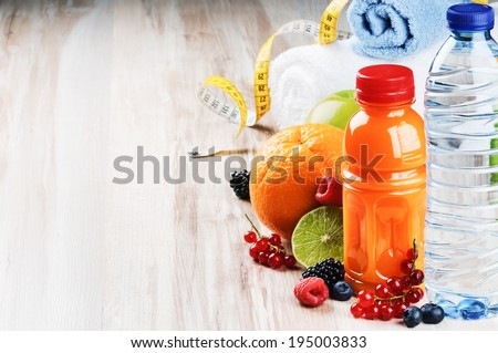Fresh fruit juice and fitness accessories. Healthy lifestyle concept