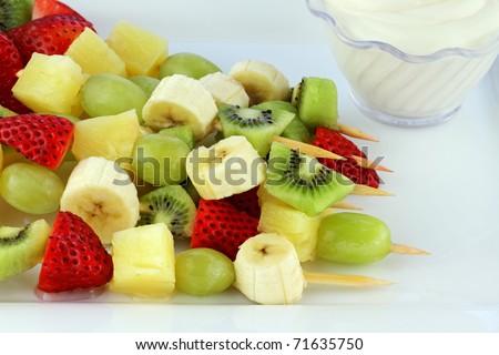Fresh fruit Kebab made of strawberries, Grapes, kiwis, bananas and pineapples. Shallow Depth of Field