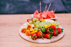 Fresh Fruit On A Wooden Table. Raw Organic Fruit Platter With Berries, Melons, Kiwi, Mango, Pineapple, Watermelon, Prickly Pear, Carambola, Strawberry.