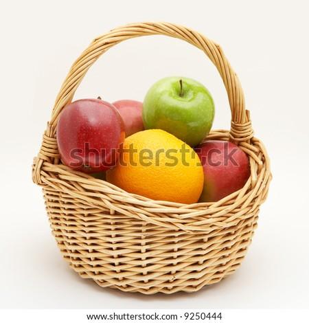Fresh fruit on basket isolated