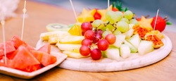 Fresh Fruit Platter. Raw Organic Fruit Platter With Berries, Melons, Kiwi, Mango, Pineapple, Watermelon, Prickly Pear, Carambola, Strawberry On The Wooden Board, On The Table, Selective Focus. Banner.