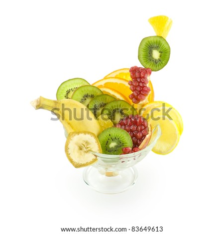 fresh fruit salad in a glass dish isolated on white