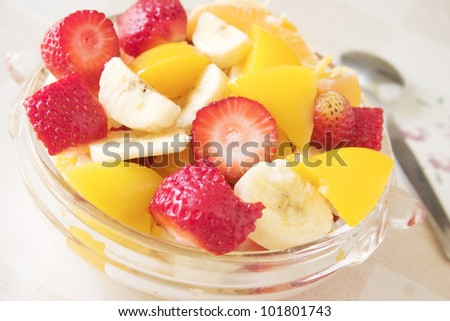 Fresh fruit salad meal  with strawberries, peaches, bananas and oranges