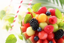 Fresh fruit salad with watermelon,melon, raspberries and blueberries in watermelon bowl.Selective Focus.
