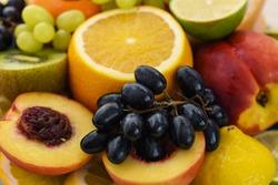 Fresh fruit slices. Grape, apple, kiwi fruits. Background of healthy fresh fruits