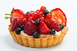 Fresh Fruit Tart with berries isolated on white background.