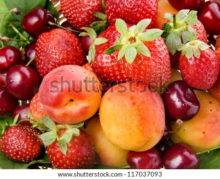 fresh fruits and berries mixed collection surface close up macro shot