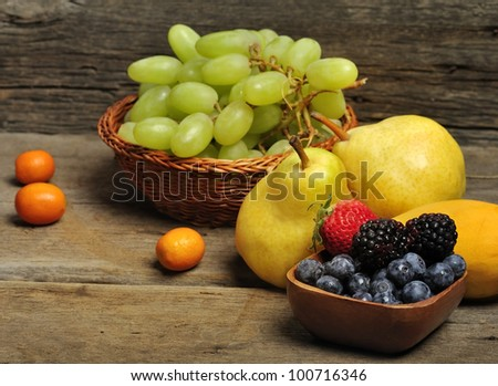 Fresh Fruits And Berries On Wooden Background