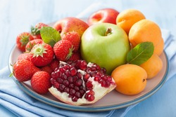 fresh fruits and berries. strawberry, apple, pomegranate