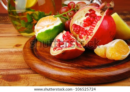 fresh fruits and tea on wooden table