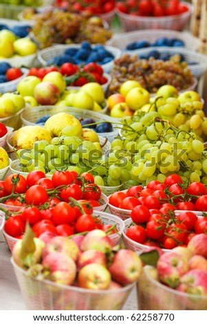 Fresh fruits and vegetables at a market stall,focus on the grapes