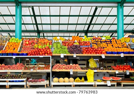 Fresh fruits and vegetables at farmers market stall