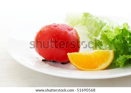 Fresh fruits and vegetables in plate,Closeup.