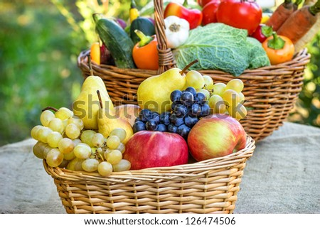 Fresh fruits and vegetables in the wicker baskets