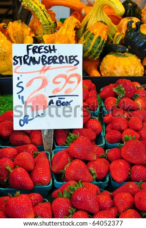 Fresh fruits and vegetables on display in a farmers market