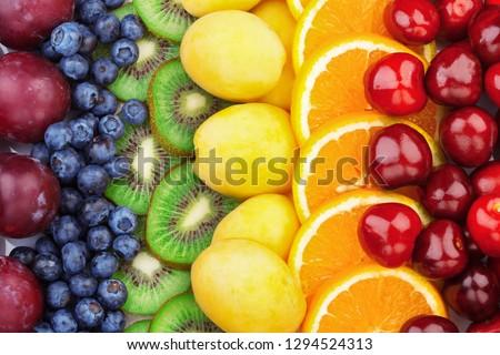 Fresh fruits.Assorted fruits colorful background. Color range