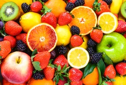 Fresh fruits background. Juicy fruits.