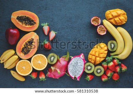 Fresh fruits. Exotic fruits on a black background #581310538