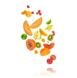 Fresh fruits flying in air. Papaya, apple, orange, kiwi, melon, citrus isolated on white. Fruity vegan tropical mix background. Colorful levitation, falling fly fruit creative concept