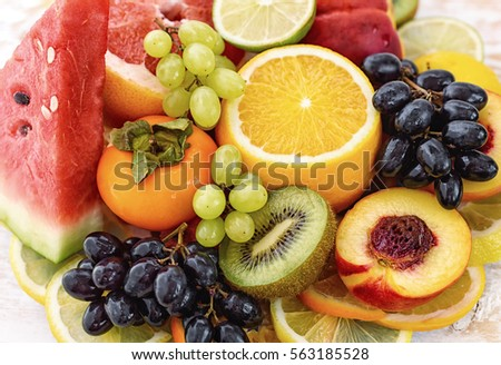 Fresh fruits Healthy food. Fruit on the table. #563185528