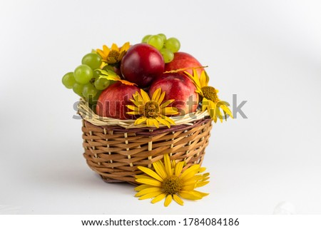 Fresh fruits. Healthy food. Mixed fruit, peaches and grapes. Studio photography of various fruits on an old wooden table. Organic healthy assorted fruits. Fruit in a basket. Fruit food background.