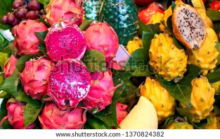 Fresh fruits in the market. Exotic fresh fruits on a market,papaya, dragon fruit,passion fruit.