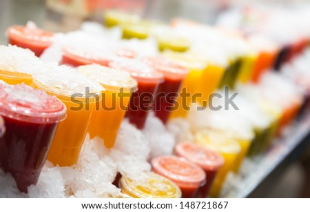 Fresh fruits juices chilled in ice
