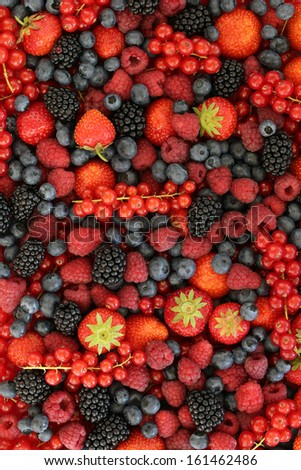 Fresh fruits like strawberries, blueberries, red currants, and blackberries forming a background