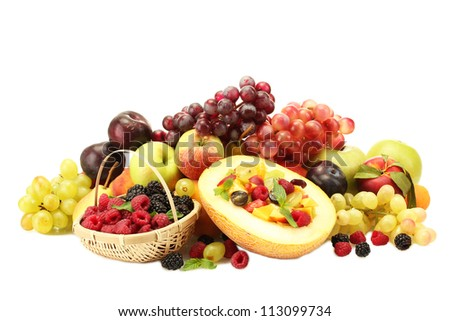 fresh fruits salad in melon, fruits and berries, isolated on white