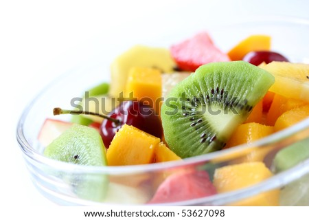 Fresh fruits salad on white background