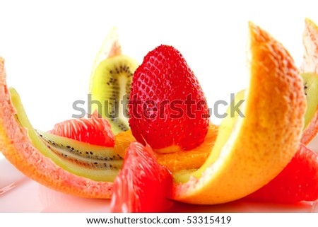 fresh fruits salad served on white plate