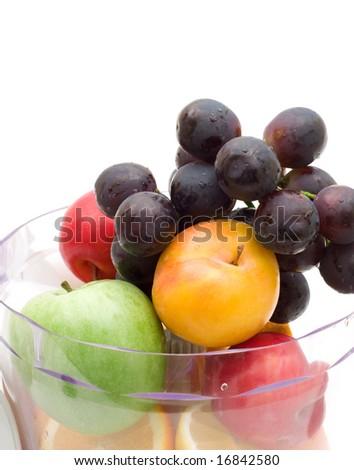 fresh fruits with juicing machine on white background