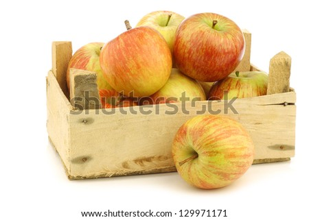 "fresh ""Fuji"" apples in a wooden crate on a white background"