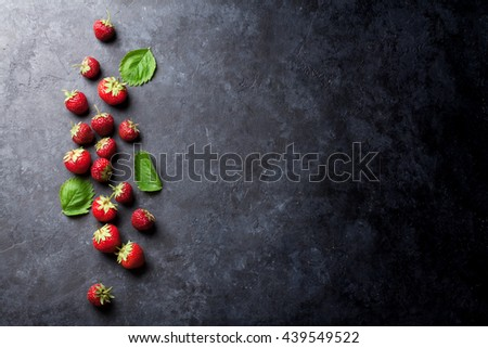 Fresh garden strawberry on stone table. Top view with copy space #439549522