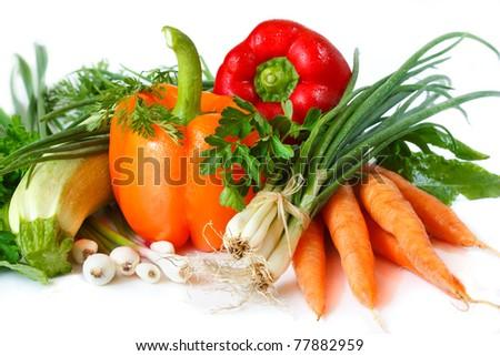 Fresh garden vegetables on a white background.