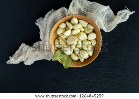 Fresh garlic heads, cloves set on a black stone surface, top view, copy space, copy space for text. #1264845259