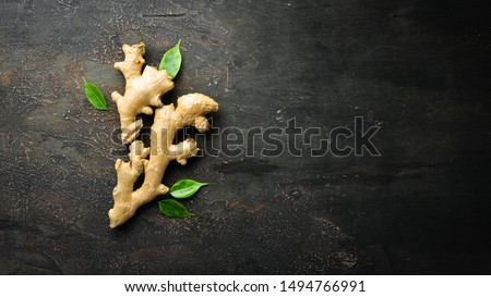 Fresh ginger root on stone background. Vitamins. Top view. Free space for your text. Foto d'archivio ©