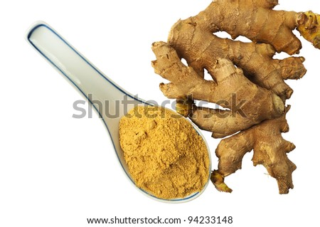 Fresh ginger roots and a ceramic Chinese spoon with ginger powder, isolated on white background