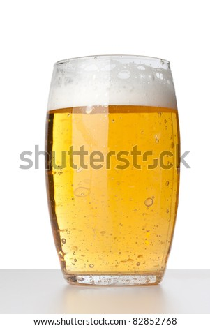 Fresh glass of beer, close up