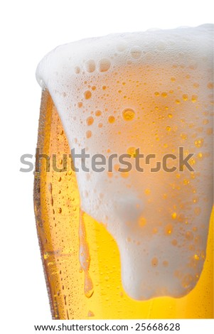 Fresh glass of beer with froth and condensed water pearls