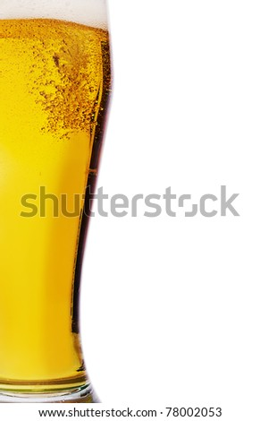 Fresh gold cold and delicious beer in curvaceous glass