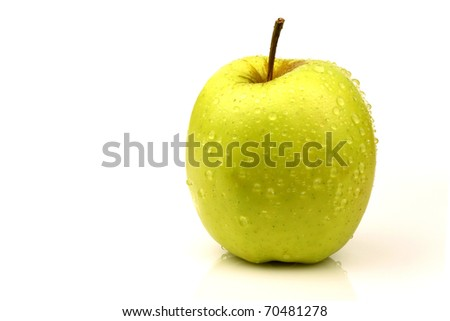 "fresh ""Golden Delicious"" apple on a white background"