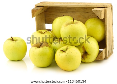 "fresh ""Golden Delicious"" apples in a wooden crate  on a white background"