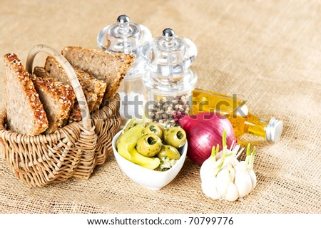 fresh grain bread with olives and spices